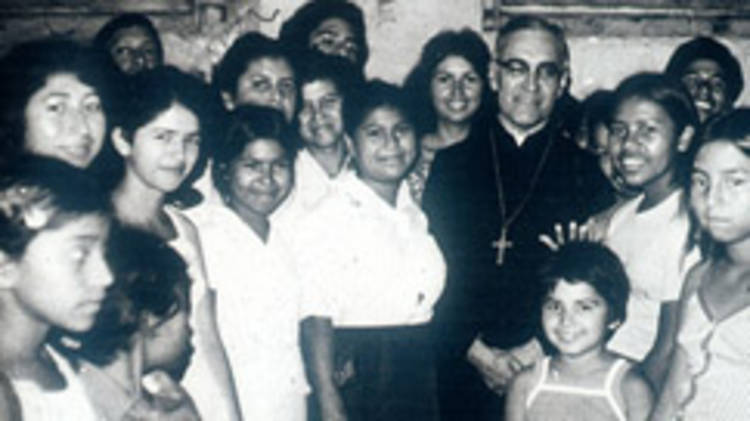 Archbishop Oscar Romero, surrounded by women from San Salvador